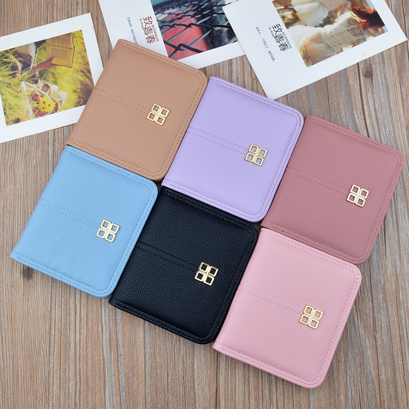New small wallet women's short wallet Korean version thin 20% discount student simple litchi grain soft leather buckle pocket