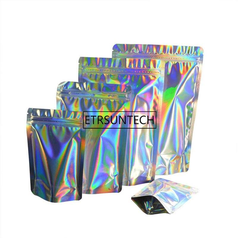 1000 Uds bolsa de PET con película de aluminio láser holograma transparente Arco Iris bolsa de embalaje de plástico con muesca de rasgado