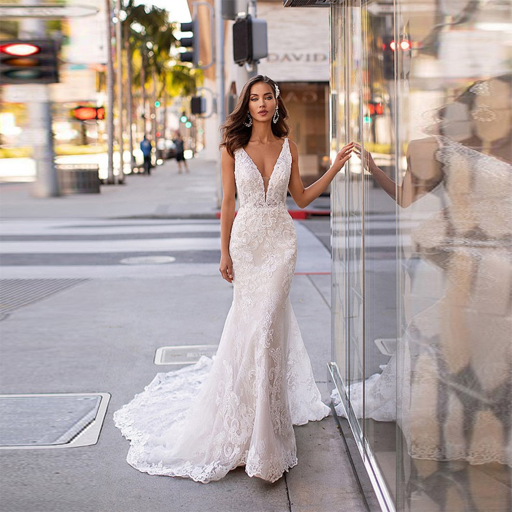 Get Sexy Deep V-Neck Wedding Dresses Sleeveless Mermaid Lace Appliqued Court Train Open Back Beach Bridal Gowns 2021