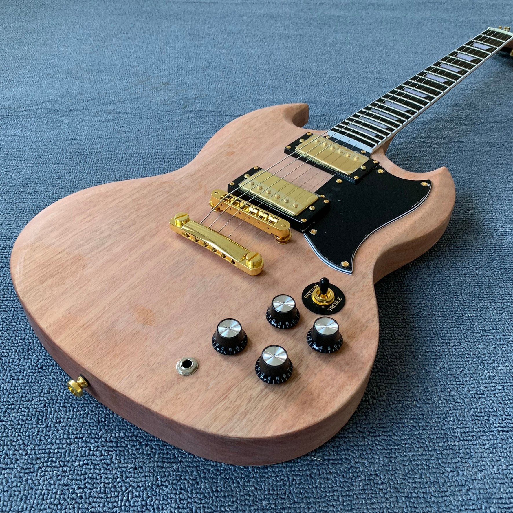 Electric guitar Partially Prepared Products , one piece body&neck,Fingerboard inlaid with blocks, Ebony Fingerboard,TonePro brid