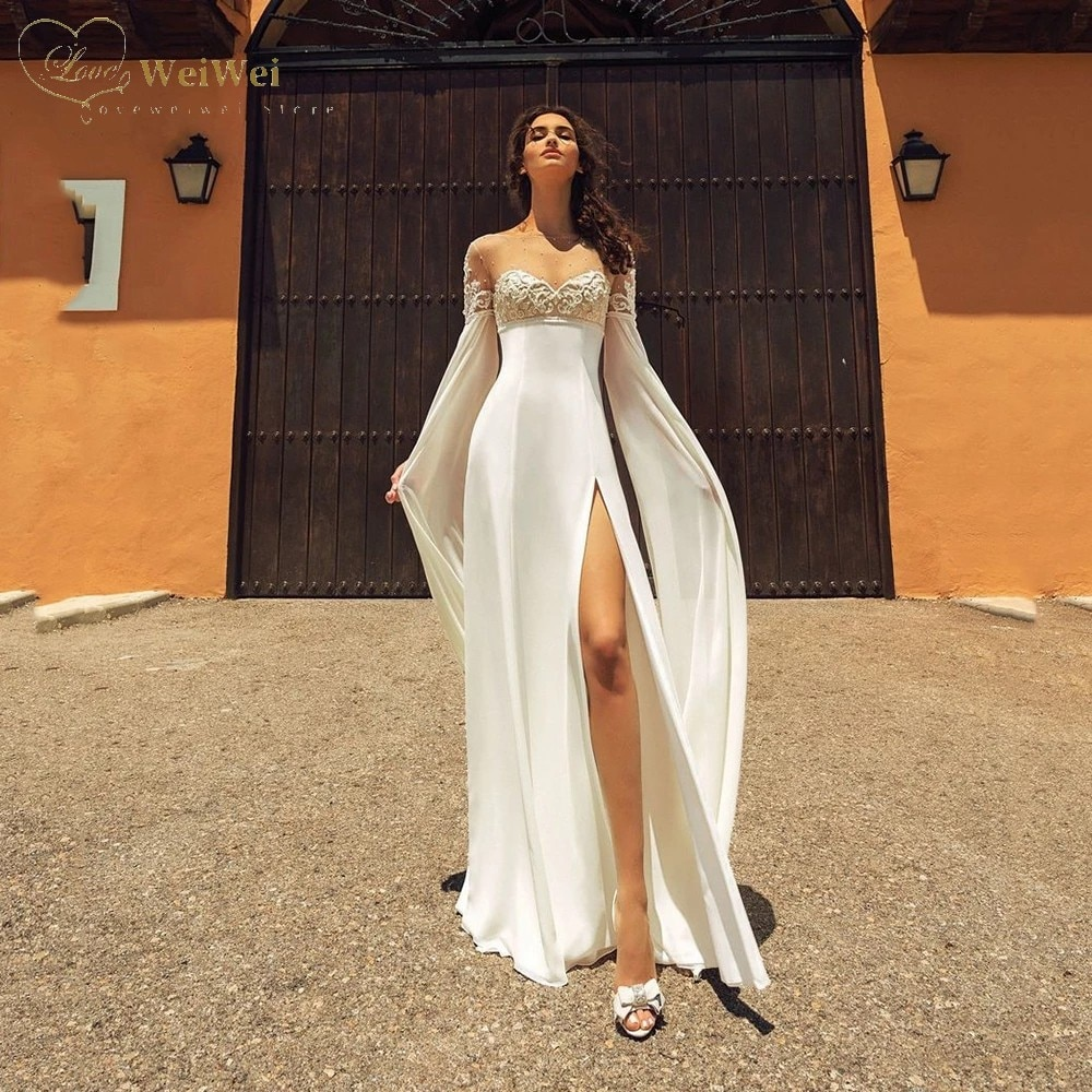 Get Exquisite Empire Satin Wedding Dress Sheer Sweetheart Neck Flare Long Sleeve Length Back Button Applique Beaded Bridal Gowns