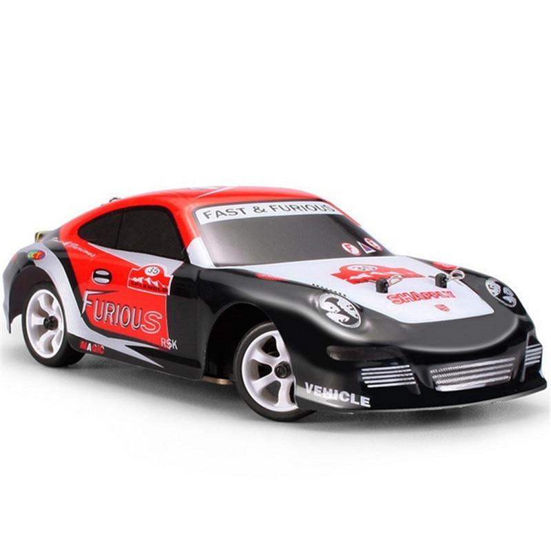 Wltoys K969 128 2,4G 4WD RC coche 4CH Crawler Vehículo de Alta Velocidad 30 km/h cepillado Drift Car Control remoto juguete de modelo de coche coches