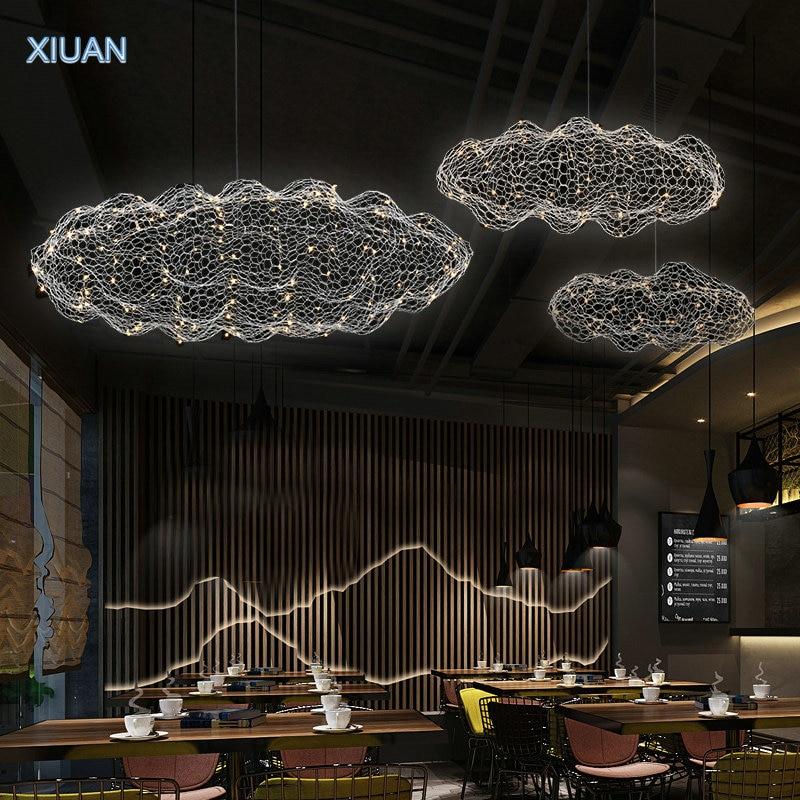 مصباح معلق LED عائم على شكل سحابة ، تصميم فني حديث ، مثالي للمكتب أو البار أو الفندق.
