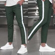 Nouveaux hommes pantalon jogging décontracté maigre côté rayure crayon pantalon mode mâle rue pantalons de survêtement pantalon fête Date Relax bas