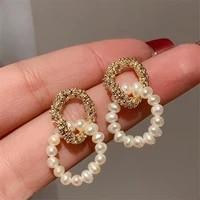 new earrings korean freshwater pearl earrings high sense of light luxury temperament earrings women
