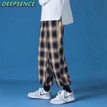 2021 New Polyester Loose Harajuku style Grid Wide Leg Pants Men Casual Drawstring Elastic Leg openin
