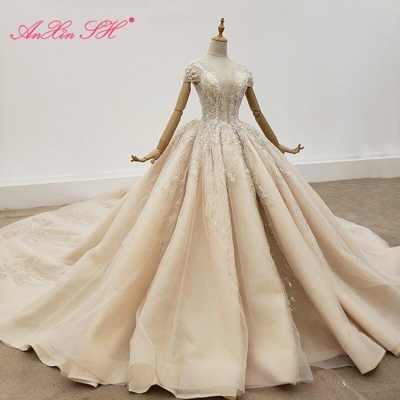 AnXin SH فستان زفاف عروس فاخر مطرز باللؤلؤ الكريستالي الشامبانيا مصنوع يدويًا برقبة مستديرة وأكمام قصيرة 100% صور حقيقية