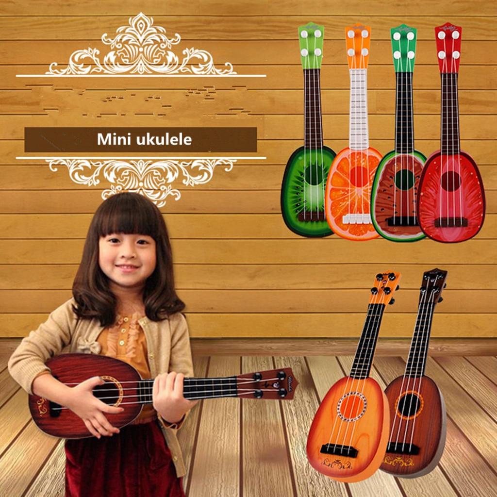 Enfants jouet en plastique robuste ukulélé Non toxique Instrument de musique préscolaire musique 4 cordes odeur guitare meilleurs cadeaux de noël