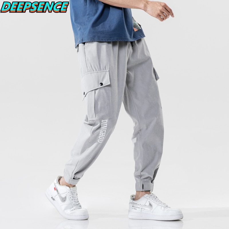 Men Four Seasons New Polyester Mid Pockets Drawstring Casual Cargo Pants Men Loose Fit Hip Hop Ins A