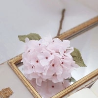 a bunch of hydrangea simulation flowers dreamy tulle cotton texture girl decoration posing cream pink angel white