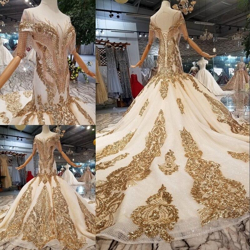 فستان زفاف ذهبي فاخر من الدانتيل بلون الشمبانيا ، بأكمام قصيرة ، 2021 ، ثوب كرة مطرز بشراشيب