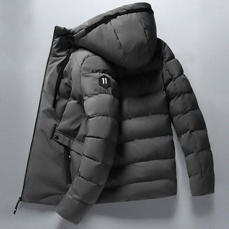 Мужская теплая непромокаемая куртка с капюшоном и защитой от ветра