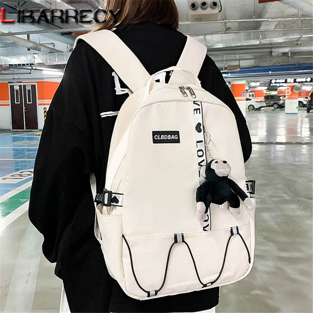 Fashion Letter Designer Ladies Backpack Cartoon Pendant Design Teenager Laptop Backpack Quality Nylo