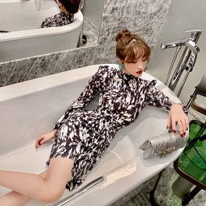 The 2021 Spring  New Women's Semi-High-Necked Printed Dress Has Long Sleeves and An Irregular Skirt