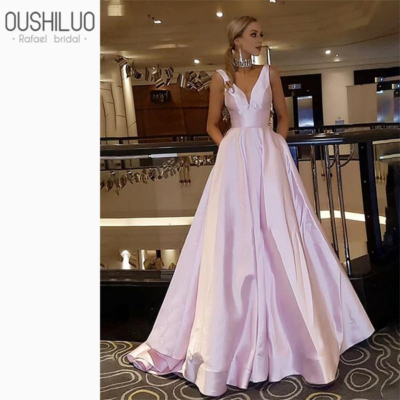 Vestidos para graduación con espalda descubierta acampanada de color rosa claro vestido de fiesta de estilo simple cuello en v profundo vestidos de invitados de boda