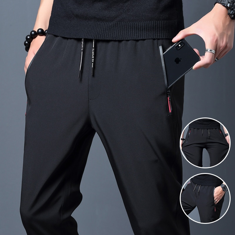 Free shippi Fashion 2021 Men Casual Pants Joggers Fitness Quick Dry Sweatpants Male Summer Breathable Slim Trousers Pencil Pants