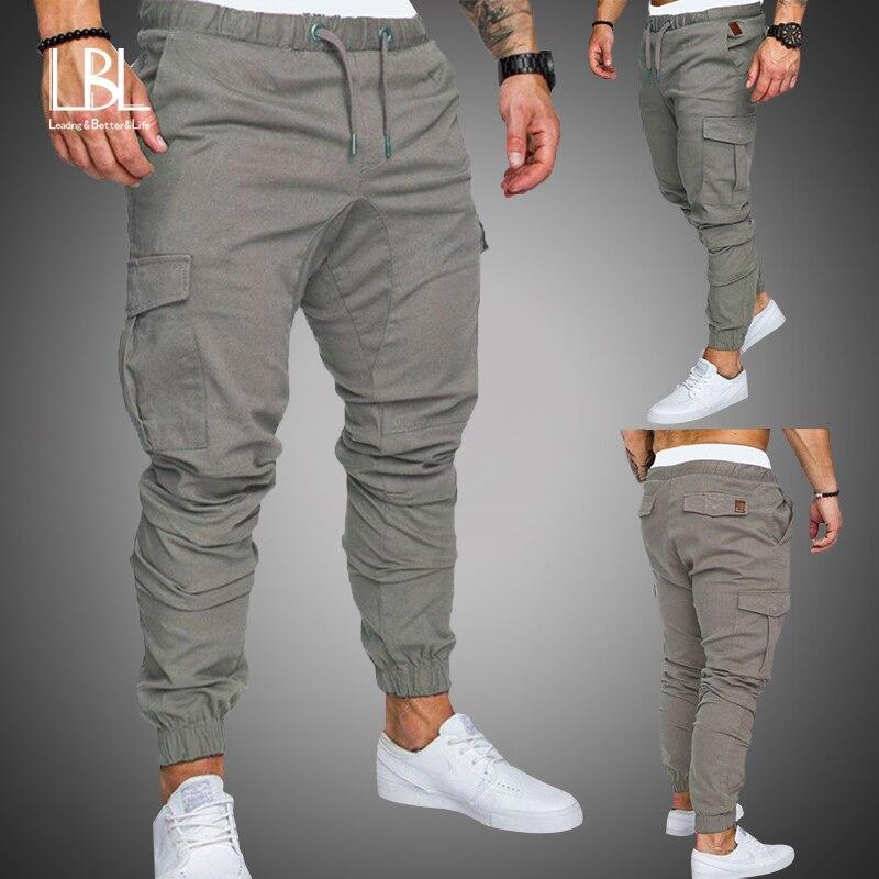2018 nueva moda pantalones de chándal Casual para hombre Pantalones de algodón pantalones de chándal para hombre Joggers pantalones a rayas gimnasios de la ropa más ropa de tamaño 5XL