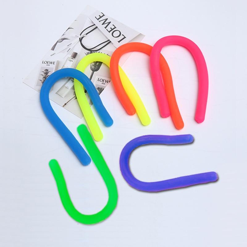Pegamento Flexible Tpr, cuerda elástica de fuerza para Fideos, cuerda de descompresión, cordón de ventilación, nuevos juguetes extravagantes, spinner antiestrés de mano
