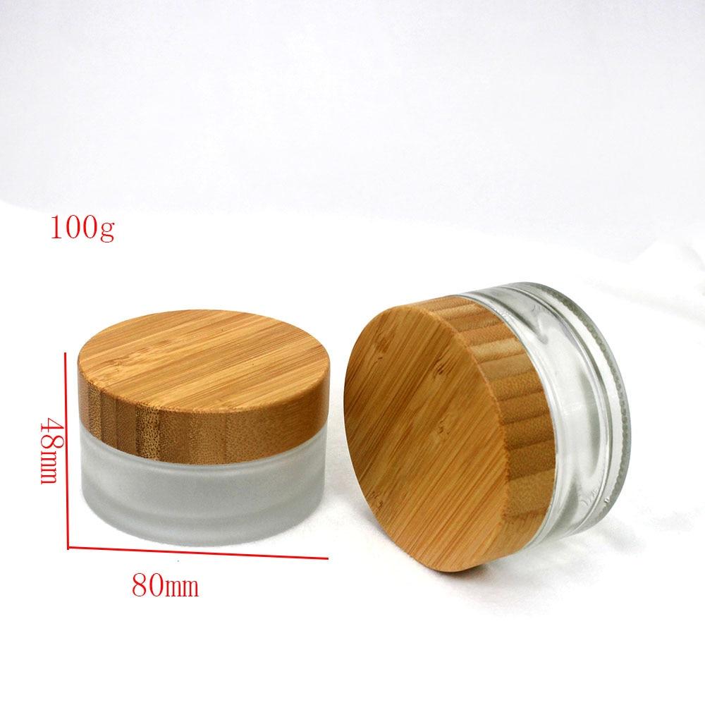 Envase de embalaje de bote cosmético de crema de vidrio con tapa de bambú de grano de madera de 100g etiqueta personalizable