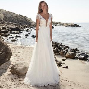 Bohemian A-Line Tulle Lace Short Sleeve V-Neck Wedding Dress Bridal Gowns 2021 Appliques Backless Sweep Train Robe De Mariée