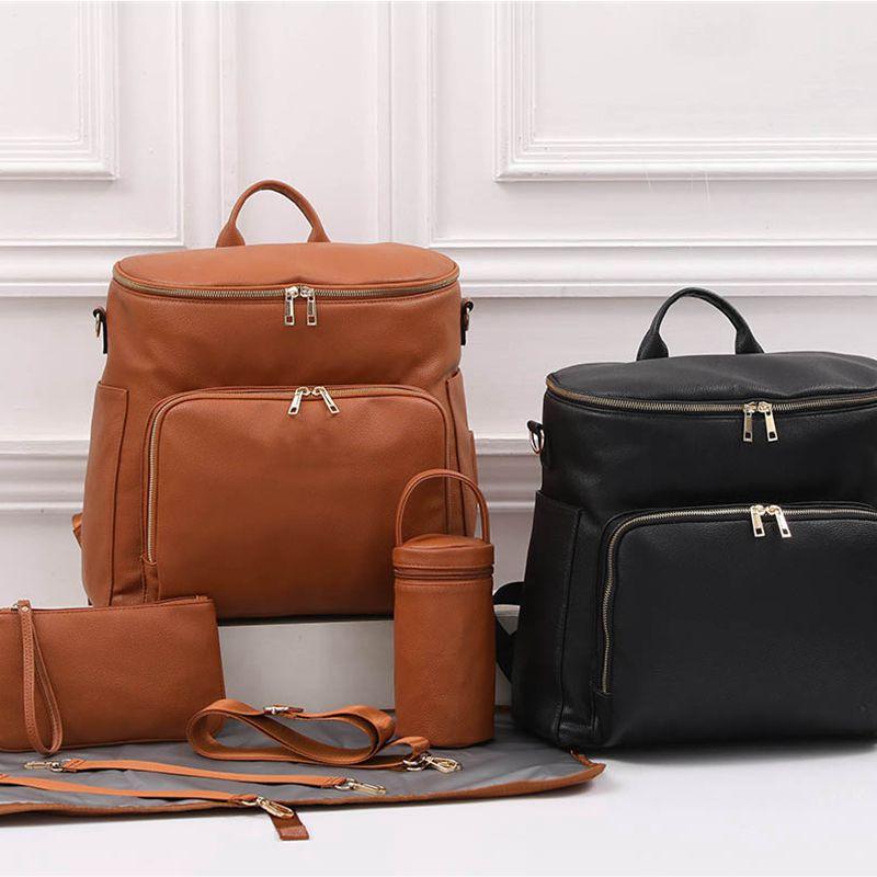حقيبة حفاضات جلدية ، حقيبة حمل للسفر ، حقيبة حفاضات للأطفال مع علاقة عربة ، جيوب حرارية ، أحزمة كتف قابلة للتعديل