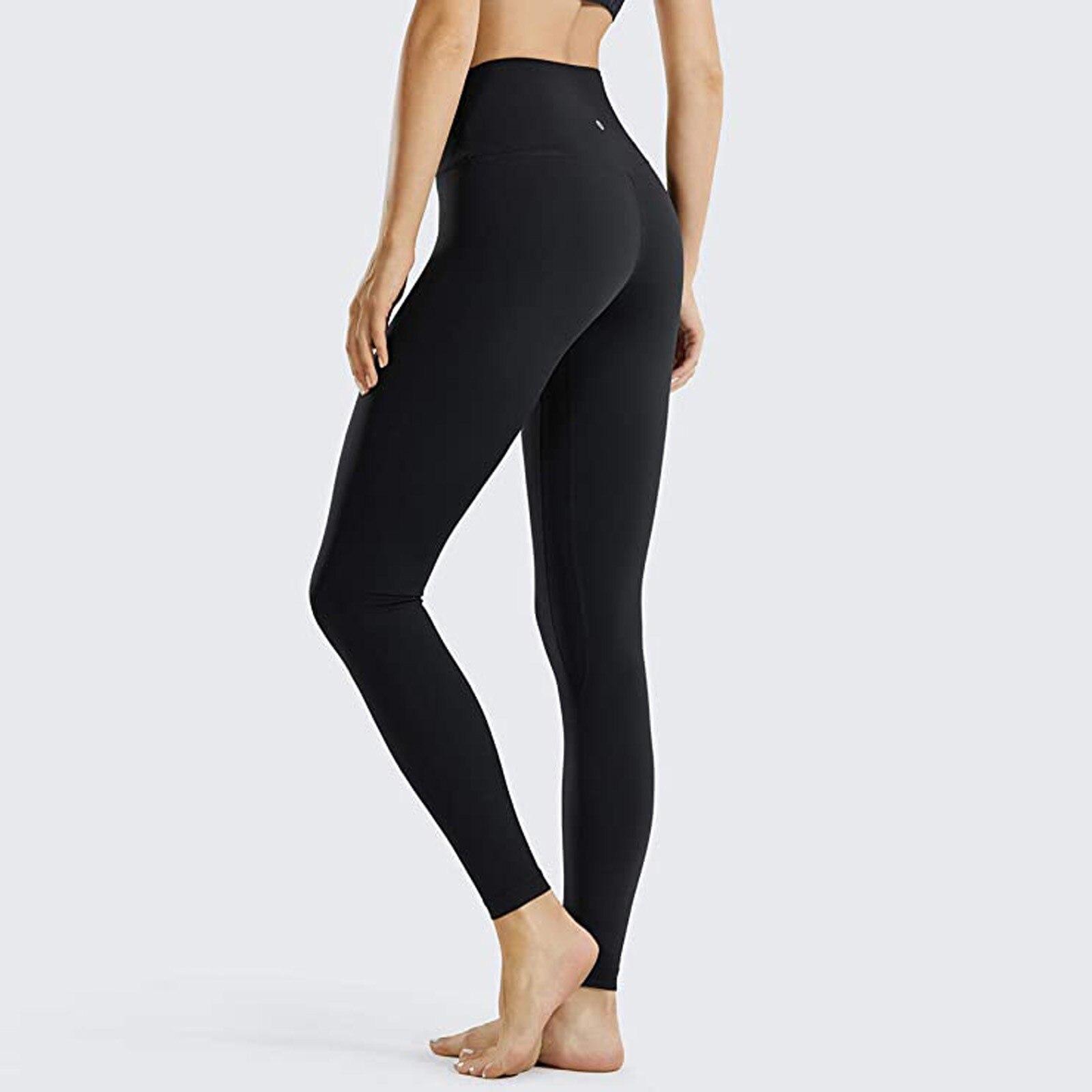 Las mujeres pantalones de Yoga de la sensación de que de cintura...