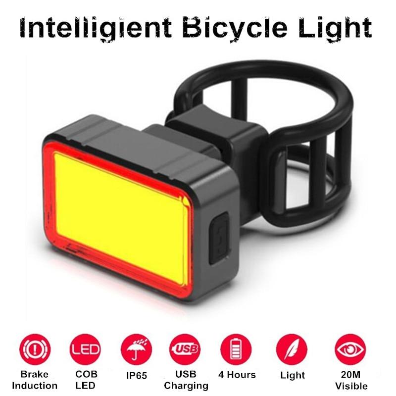 100LM impermeable USB recargable inteligente de inducción de freno de bicicleta luz trasera COB trasera + 28 LED de bicicleta de noche de conducción
