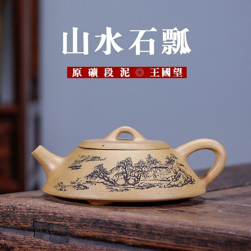 Tetera de cerámica esmaltada de color rojo oscuro sección mud famoso reino en Manual tetera juego de té de viaje venta al por mayor de cabello de generación de agentes