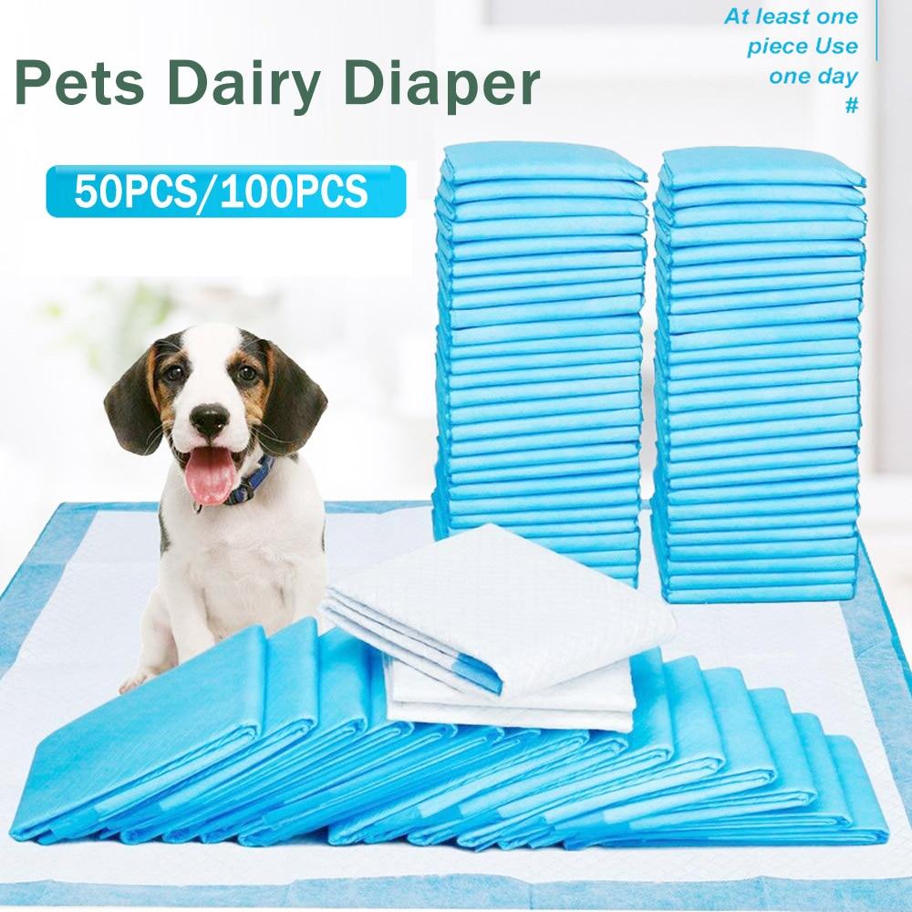 50/100 Uds perro pañal para caca de PIs de Super absorbente pañal desechable para mascotas pañal limpio Mat para mascotas lácteos pañales suministros