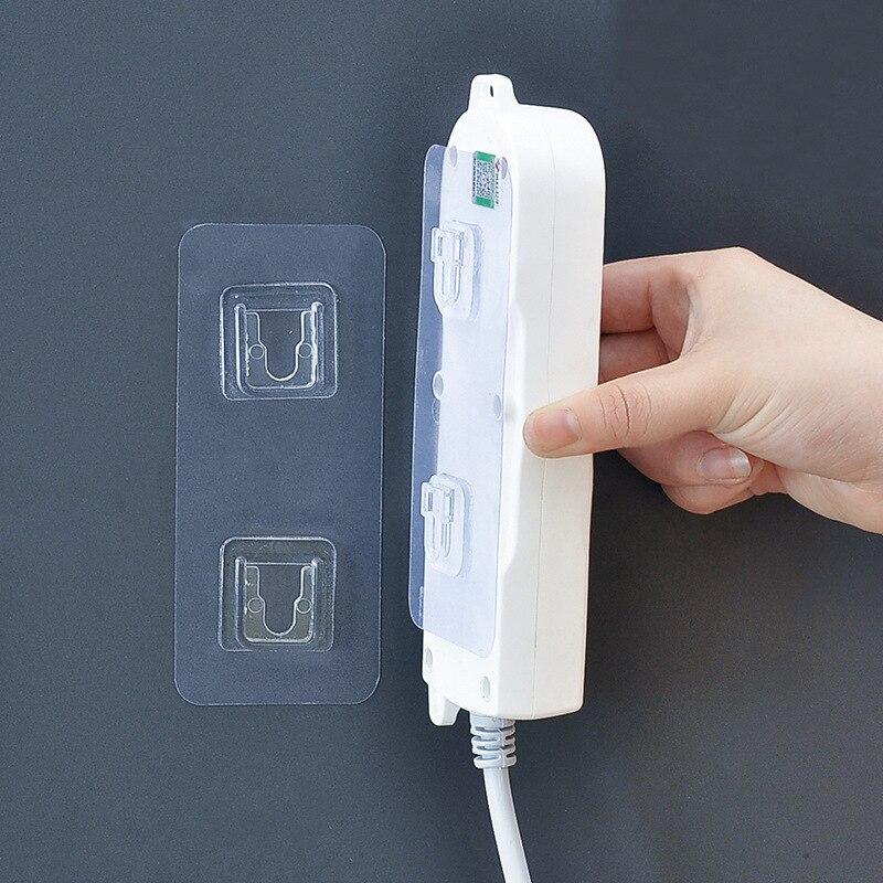 Fijador de enchufe autoadhesivo montado en la pared sin golpe soporte de tira de alimentación organizador transparente para el hogar 1 Juego