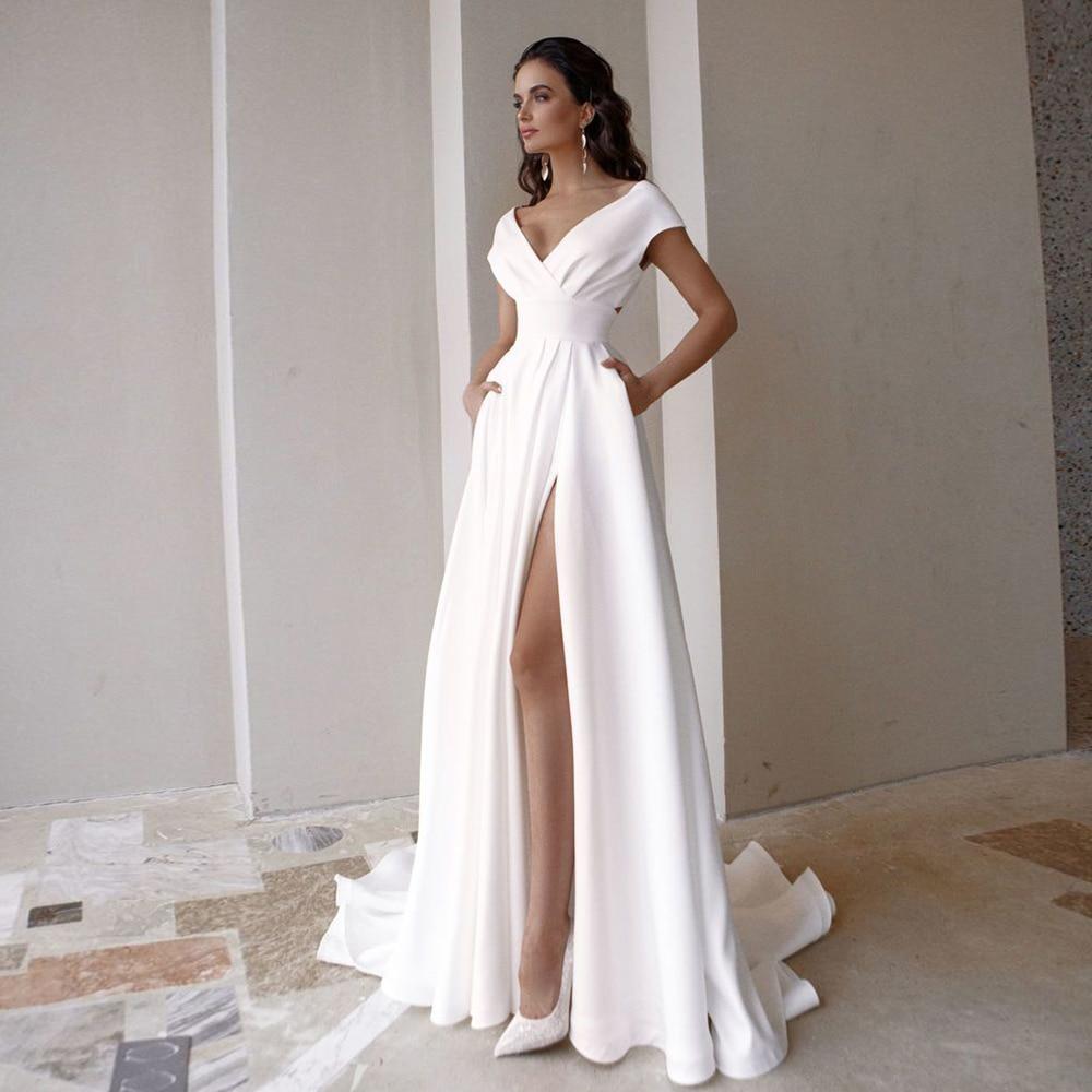 Modest V-Neck Wedding Dress 2021 Fashion Short Sleeve Sweep Train Slit A Line Bridal Gown with Pocke