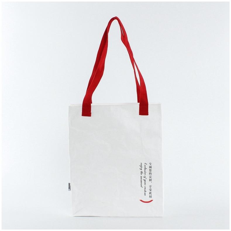 Venta al por mayor 1000 Uds lavado kraft bolsas de papel de Tyvek mensajero literaria casuales de las mujeres bolsa de compras de logotipo