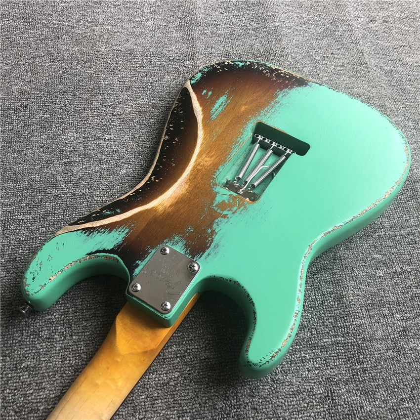In stock, green antique relic, electric guitar, green guard board, cow bone string pillow. Nitro paint. Real photos. Free shippi enlarge