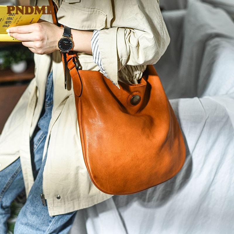 PNDME بسيطة عادية لينة جلد طبيعي المرأة حقيبة ساعي الموضة الرجعية الفاخرة جلد البقر الطبيعي السيدات حقيبة كتف الشارع
