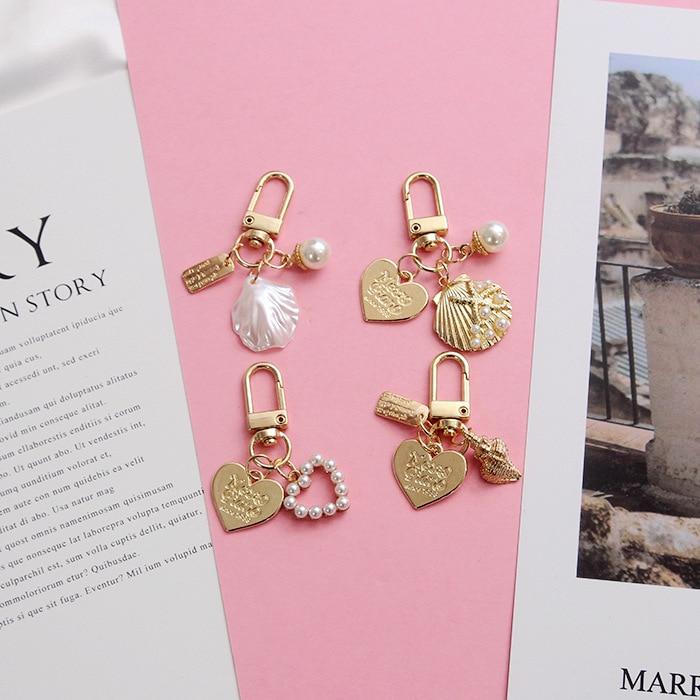 Llavero con perlas de concha de moda, llavero con colgante de corazón, serie con diseño marino creativo, llavero, accesorios de joyería, llavero de niña