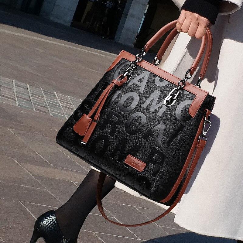 100% حقائب يد جلدية حقيقية 2021 جديد سعة كبيرة حقيبة محمولة طباعة موضة ضرب لون واحد الكتف حقيبة ساعي Gg