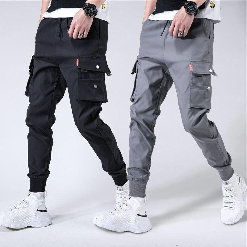 Pantalones Harem con bolsillos laterales para hombre, otoño 2020, Hip Hop, diseño informal de cintas, pantalones de Joggers para hombre, pantalones de calle a la moda, pantalón negro