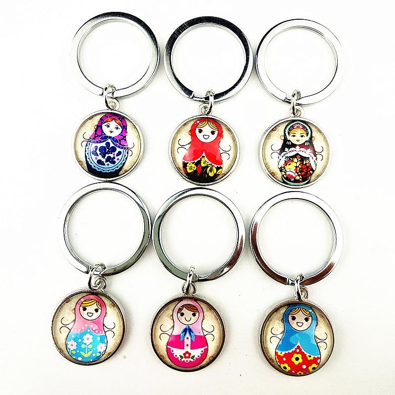 Jiangzimei 24pcs 2020 new designs Russian Doll bracelet Matryoshka cartoon Image Glass cabochon key ring for Girls party gift