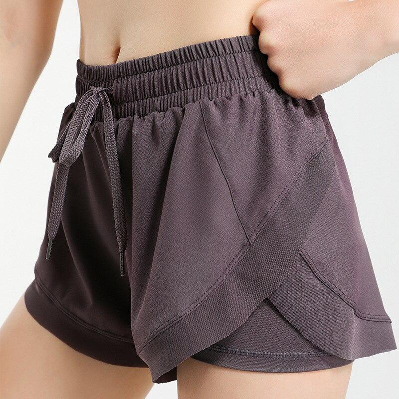 Летние женские спортивные короткие быстро сохнут свободные эластичные спортивные штаны Jogger упражнения одежда женская одежда для бега повс...