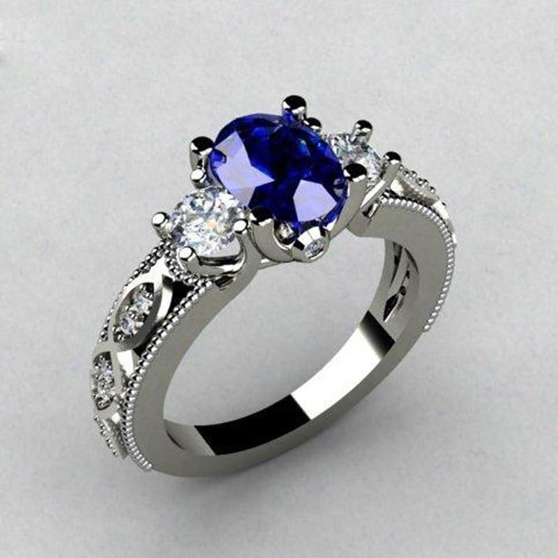 Huitan-Anillo de boda de piedra azul Ovalada para mujer, Triple Cristal de lujo, con diseño de lujo, joyería