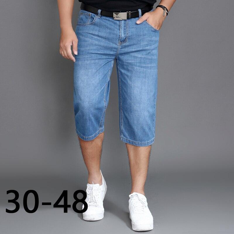 Talla grande 46 48, pantalones vaqueros de talla grande para hombre, pantalones elásticos clásicos, pantalones elásticos sueltos de pierna ancha que aumentan la ropa de calle recta, pantalones de longitud de la pantorrilla