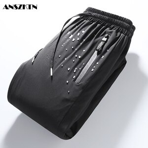 ANSZKTN new style 2020 new down pants winter thickening warm wind-proof white duck down foot pants over the cold sweatpants