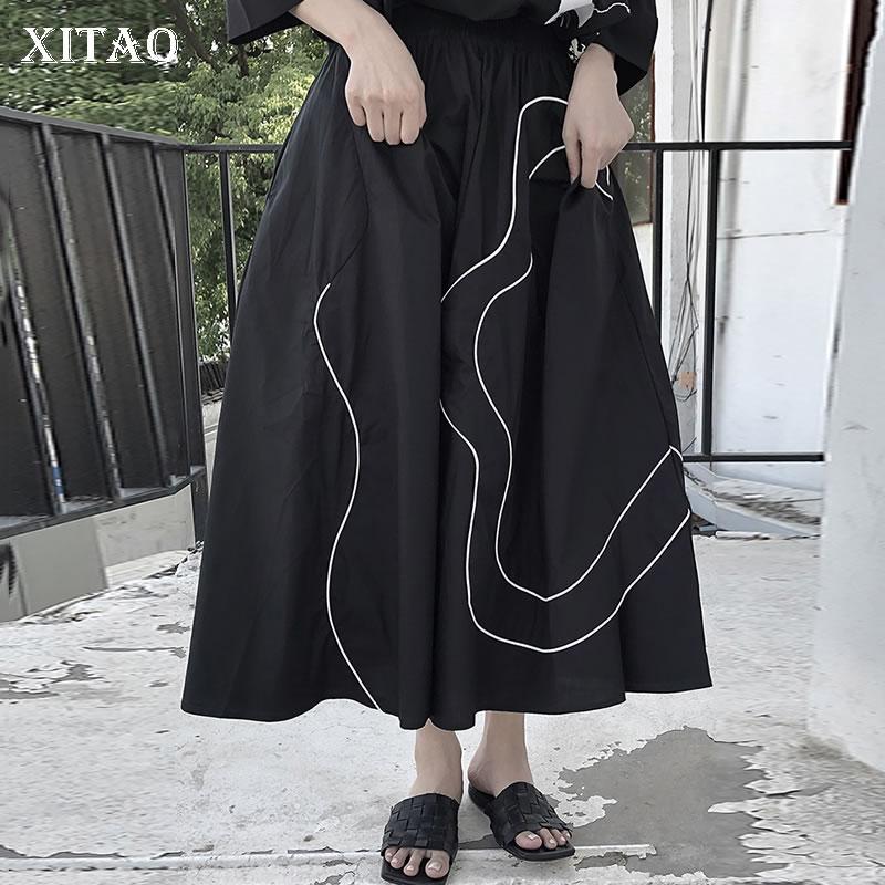 تنورة جديدة سوداء من XITAO بتصميم غير منتظم ومشرقة مزينة بخطوط صيفية فضفاضة للنساء غير رسمية وبساطة عصرية تناسب جميع الأعمار WMD1133