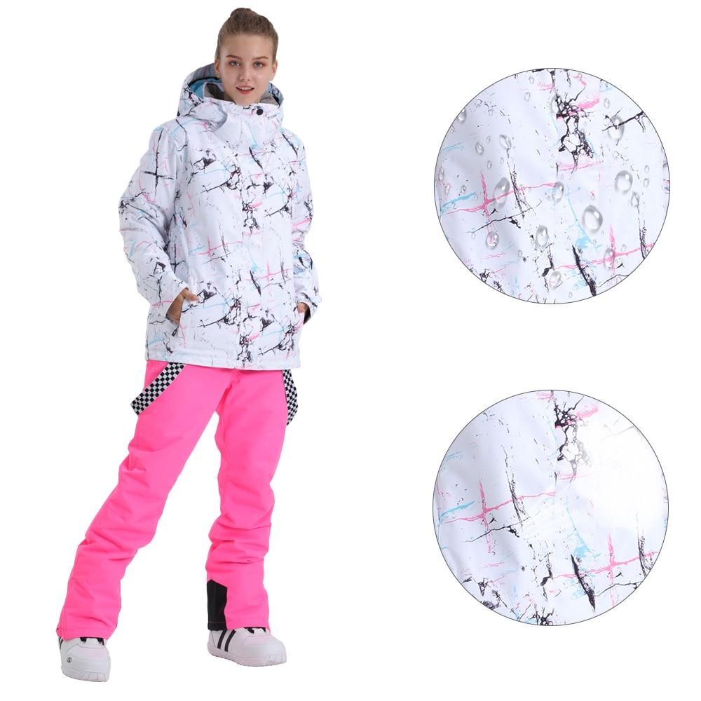 SMN بدلة تزلج المرأة على الجليد سترة المرايل السراويل الشتاء مقاوم للماء تنفس دافئ مقاوم للريح في الهواء الطلق ارتداء على الجليد دعوى