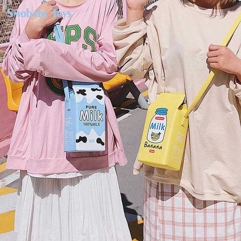 2020 nueva mochila de felpa de fruta bonita rosa fresa leche PU cartera bolso de hombro estilo creativo mochila niña regalo SMOBABY Juguetes