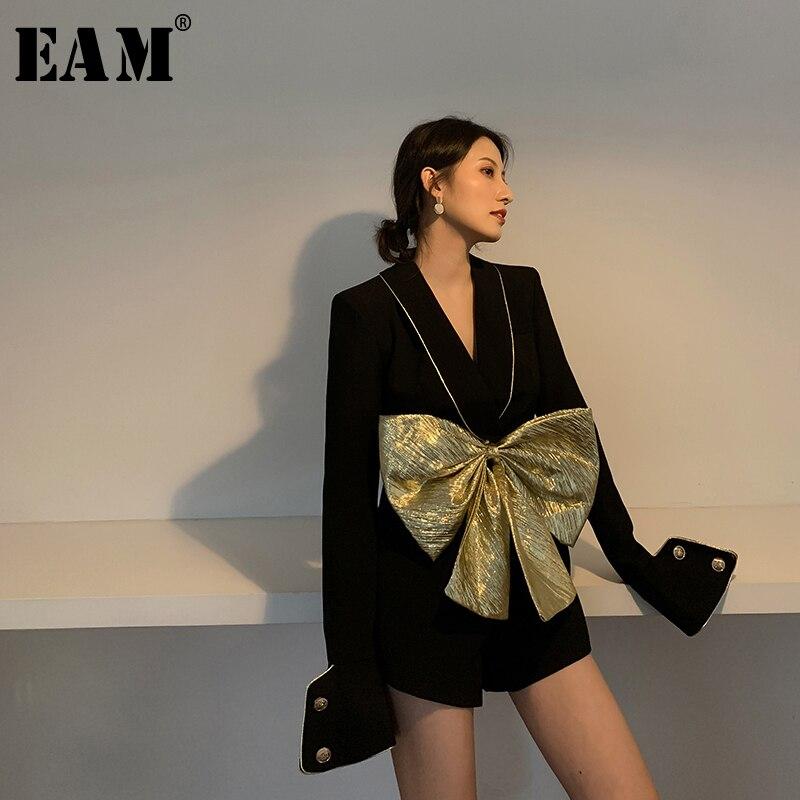 EAM-جمبسوت نسائي بفتحة وقوس أسود ، ملابس فضفاضة ، خصر مرتفع ، جيب ، غرزة ، موضة المد ، ربيع خريف 2021 ، 1W481