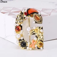donia jewelry europe and the united states new luxury classic alloy shell pearl letter brooch retro fashion ladies jewelry pin