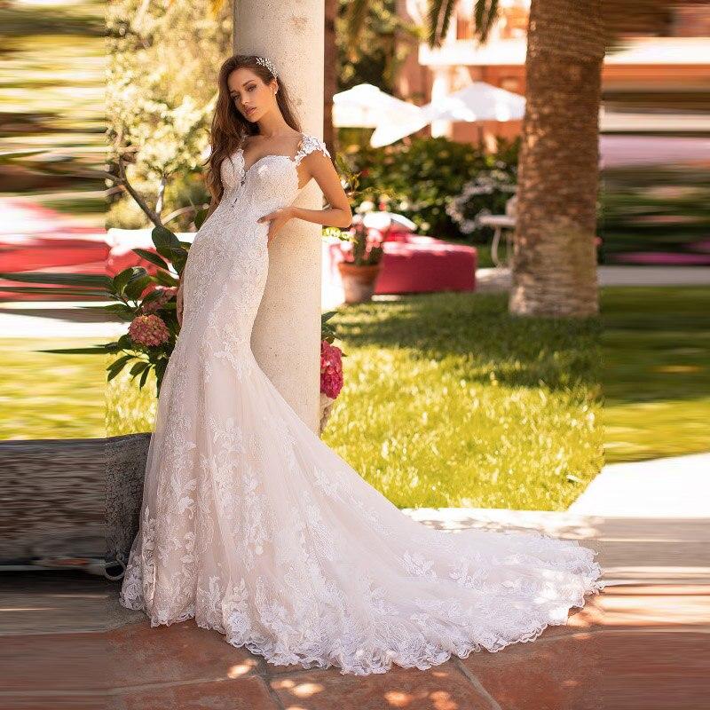 Délicat en vente dentelle sirène retour sur robes de mariée de mariée manches capuchon chérie robes de mariée pour mariée Court Train 2020