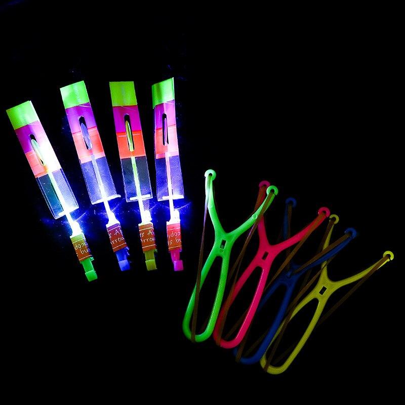 2 pièces/ensemble extérieur brillant fusée Flash LED fronde élastique hélicoptère rotatif volant jouet flèche cadeau enfants fée catapulte
