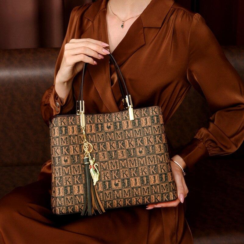حقائب يد جلدية ذات سعة كبيرة 2021 الخريف حقائب جديدة كبيرة الاسم رسول حمل الحقائب عالية الجودة المرأة المحفظة وحقائب اليد